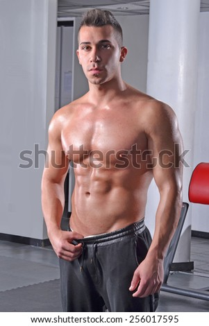 Strong fitness young man and body shape abdominal muscles. - stock photo