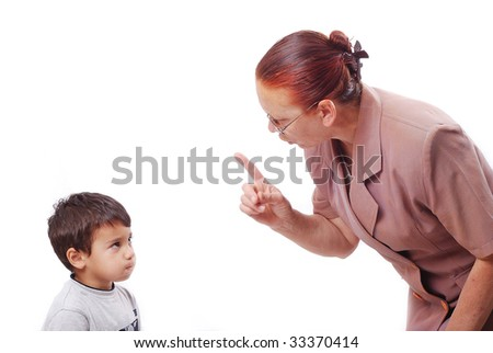 Strong grandmother is talking hard talk with her grandson - stock photo