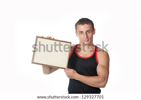 strong guy holding frame for text in the hands on white background - stock photo