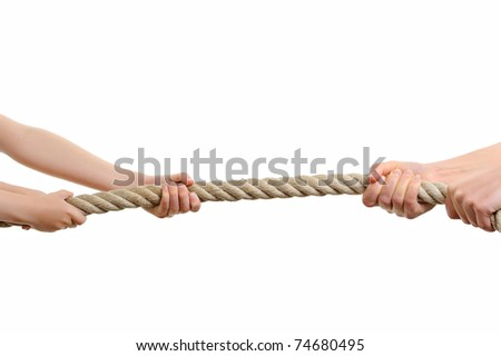 strong hands pulling a rope to win - stock photo