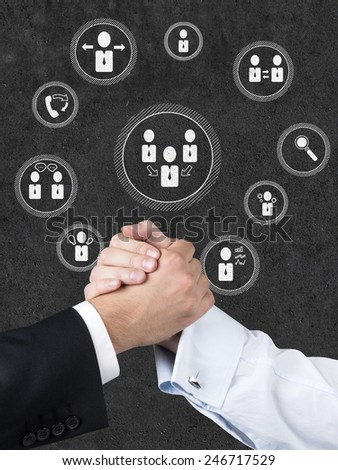 strong handshake and  partnership icons on a gray background - stock photo