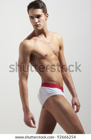 Strong handsome fitness sports man in underwear - stock photo