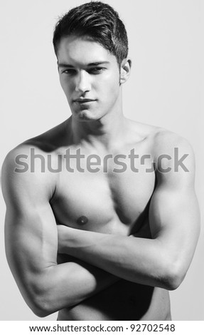 Strong handsome fitness sports man looking into the camera - stock photo