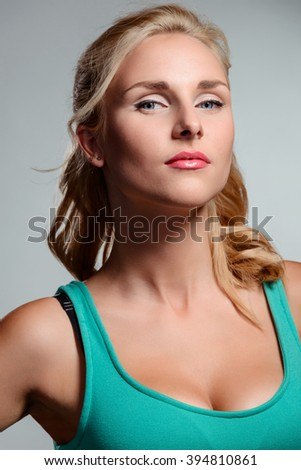 Strong having-it-all woman looks right in a camera. Natural beauty blossom. Nice close-up portrait. - stock photo