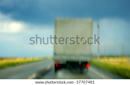 Strong lateral wind on highway during a rain - stock photo