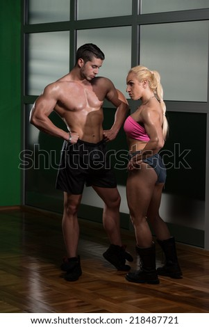 Strong Man And Woman Posing Bodybuilding - stock photo