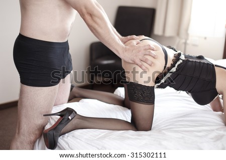 Strong man grasp sexy woman ass, body in lingerie - stock photo
