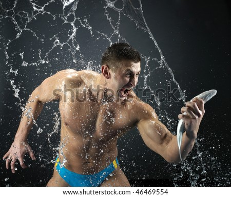 Strong man have just caught  the fish - stock photo