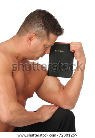 Strong man holding Holy Bible - stock photo
