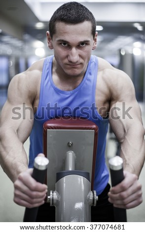 strong man is engaged in the gym