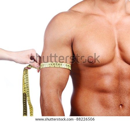 Strong man measuring his arm, isolated on white