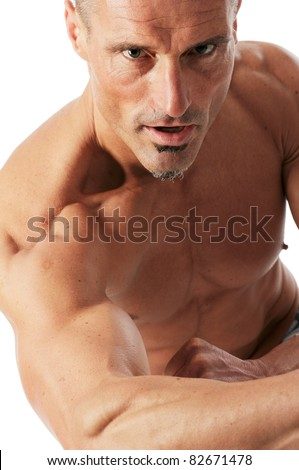 Strong man portrait. Studio shot against a white background. - stock photo