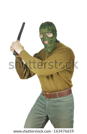 Strong man threatens with a rubber baton