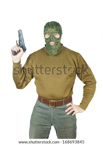 Strong man wearing camouflage mask holds a gun