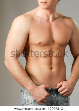 Strong man with a helathy body isolated over white background - stock photo