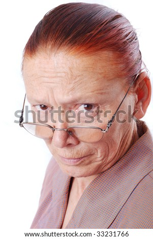 Strong middle aged teacher with glasses looking - stock photo