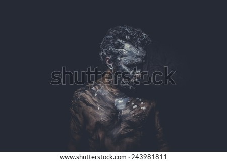 strong naked wild man with tribal paint - stock photo
