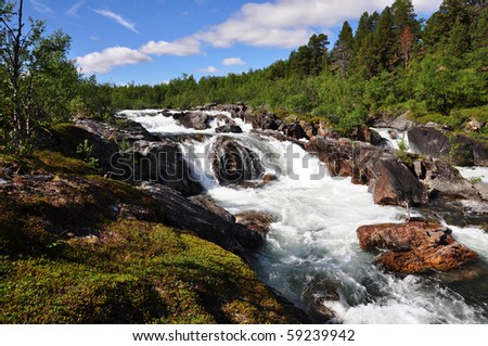strong rapids in Abisko national park, Sweden, Scandinavia - stock photo