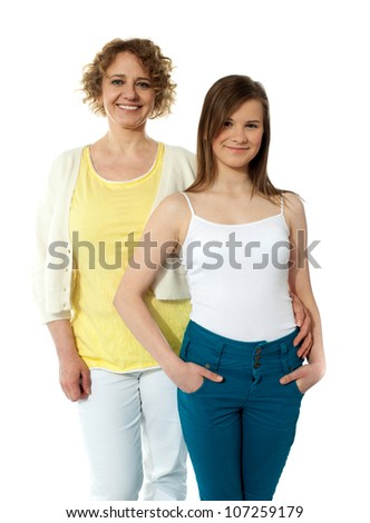 Strong relationship. Mother and daughter posing in front of camera