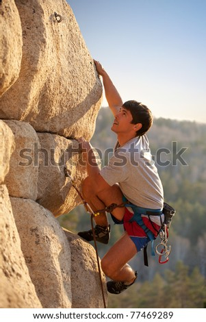 Strong rock-climber - stock photo