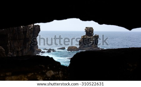 strong sea, waves, bad weather, and rock with seagulls in Peniche, Portugal - stock photo