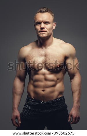 Strong shirtless muscular man showing his athletic torso. - stock photo