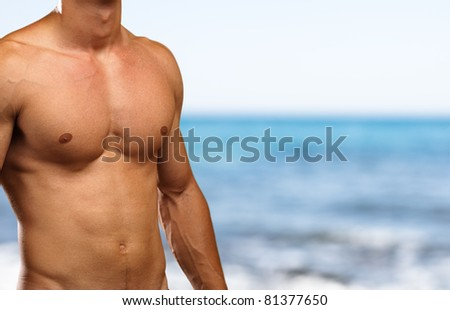 strong torso against a sea background
