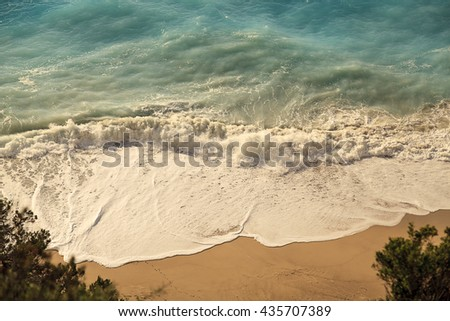 Strong waves crash over the beach, view from the top. Waves. Beach. Waves. Beach. Waves. Beach. Waves. Beach. Waves. Beach. Waves. Beach. Waves. Beach. Waves. Beach. Waves. Beach. Waves. Beach. Waves - stock photo