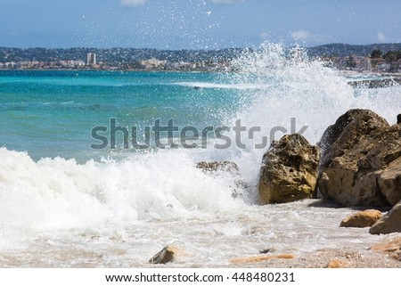 Strong waves in a sunny day - stock photo