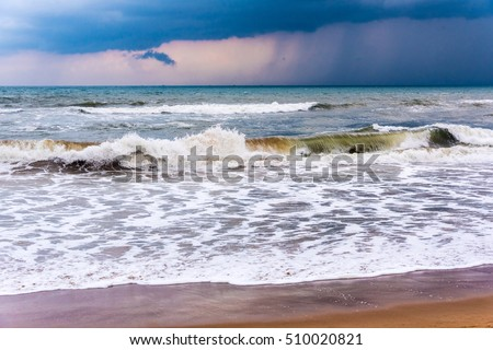 Strong waves of Bay of Bengal sea under a stormy evening sky