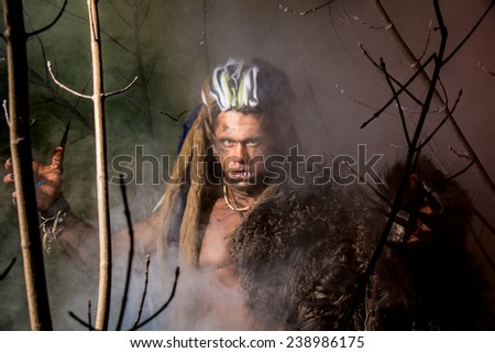 Strong werewolf, demon among the trees. The image of a formidable enemy. - stock photo