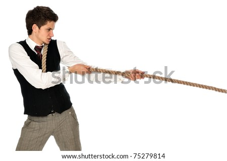 strong-willed man pulling of a rope and wins as a symbol of success - stock photo