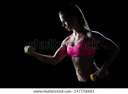strong woman athlete working with weights - stock photo