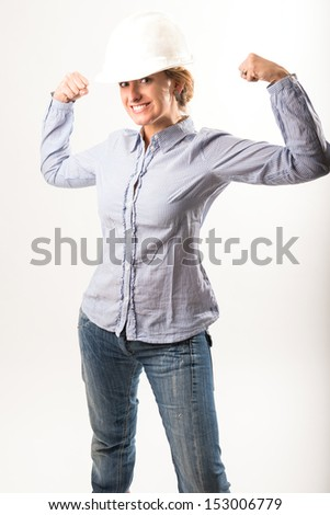 Strong woman wearing a helmet - stock photo