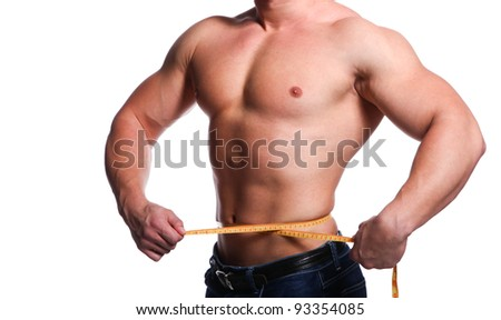Strong young body of athlete man with centimeter - stock photo