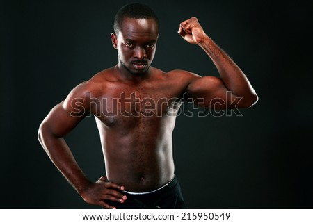 Strong young man showing his muscular