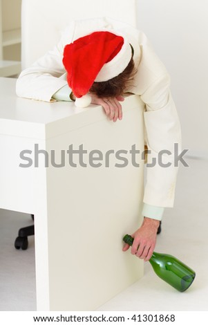 Strongly drunk businessman during celebrating of new year - stock photo
