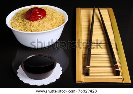 Strow mat, chopstiks, bowl witn noodles, sauce - stock photo