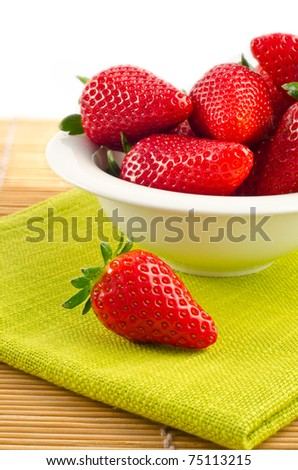 strowberries in a white bowl with green towel - stock photo