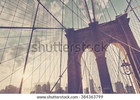 Structural detail of the Brooklyn Bridge looking up at the network of cables close to a central tower, New York, USA - stock photo
