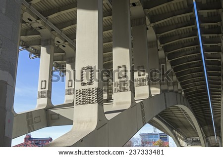 Structural elements of highway bridge - view from below. - stock photo