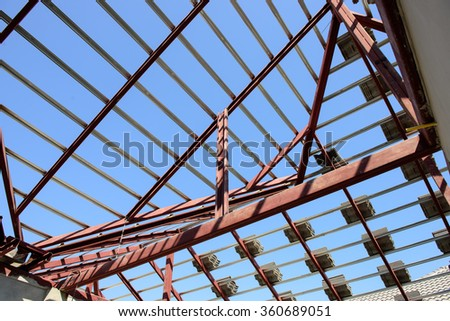 structural steel beam on roof of building residential construction - stock photo