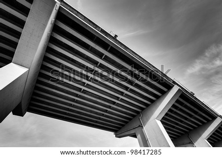 Structure of a bridge with the sky in the background. Black and white photography. - stock photo