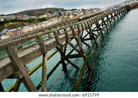 Structure of a high wooden pier in Fecamp, France