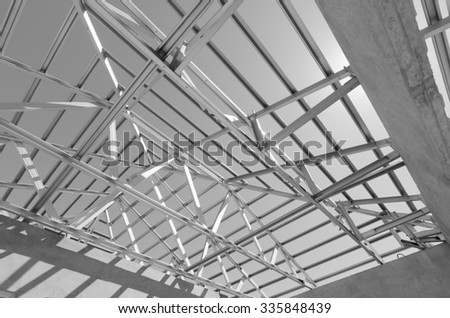 Structure of steel roof frame for construction. In Black and White. - stock photo