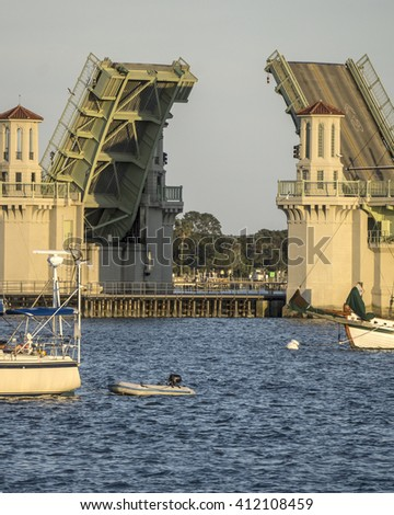 Structure opening/Draw Bridge at Saint Augustine Florida/Evening traffic is halted as a vessel travels under the bridge - stock photo