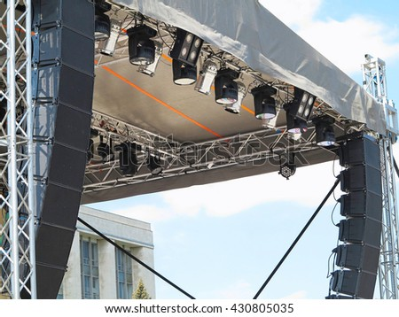 Structures of stage electric illumination spotlights equipment and speakers - stock photo