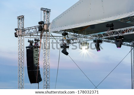 Structures of stage spot lights equipment and loudspeaker on stage - stock photo