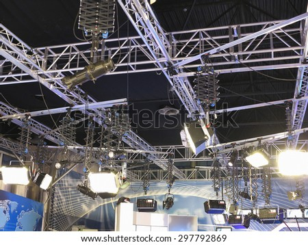 structures of tv studio illumination lights equipment and projectors - stock photo