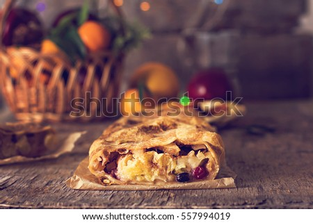 "to ""strudel and winter decor. Apple strudel (pie) with dried fruits ..."